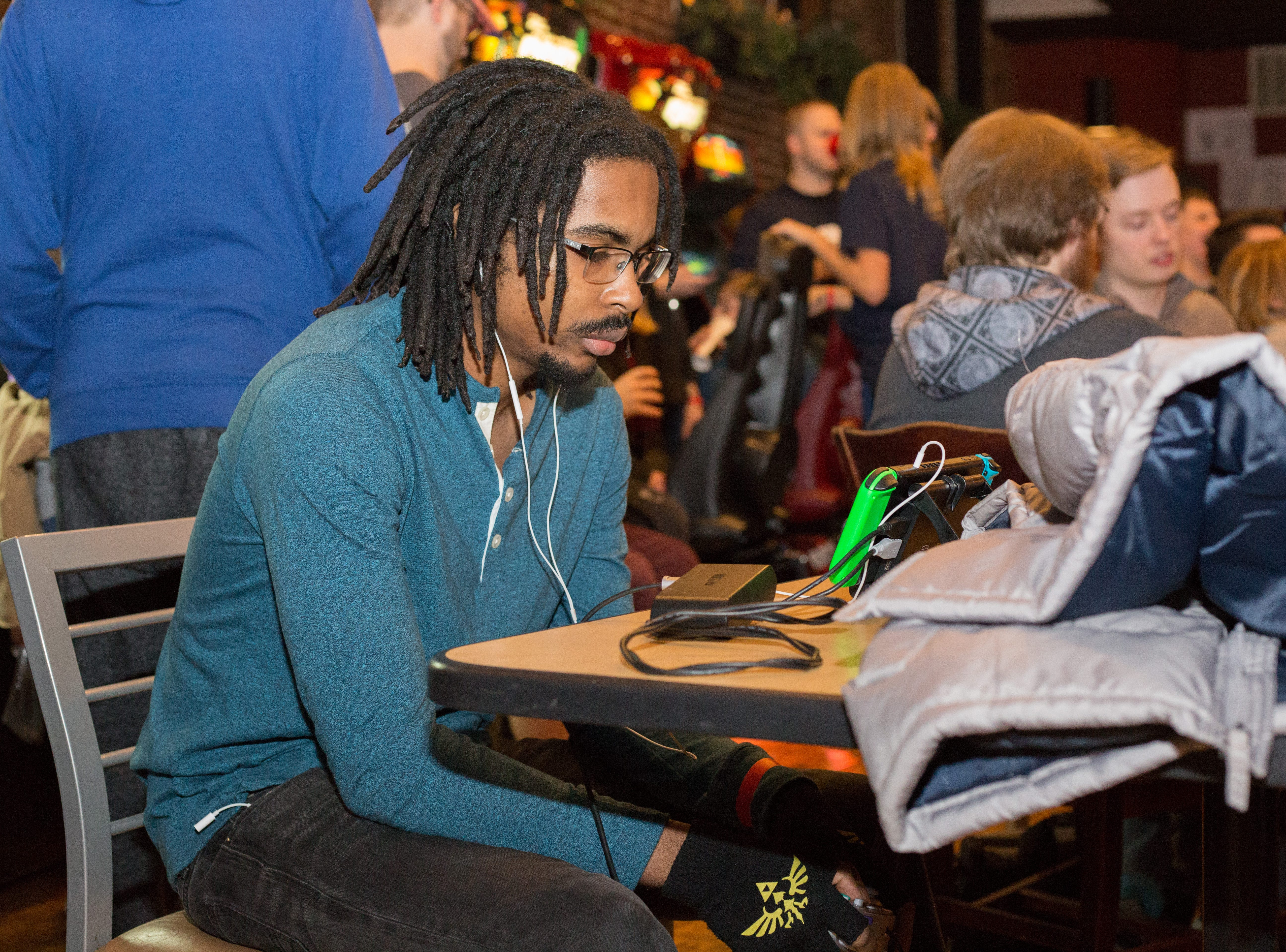 Andrew Reid plays at his table during a Super Smash Brothers Ultimate Tournament presented by Big Dad Games at Filly's Game and Grill in Gallatin on Monday, Jan 14.