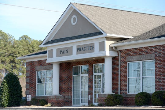 A PainMD clinic in Denver, North Carolina, is one of the dozens of pain clinics accused of giving patients unnecessary injections to defraud the government. This is not one of the four Tennessee clinics that are closing.