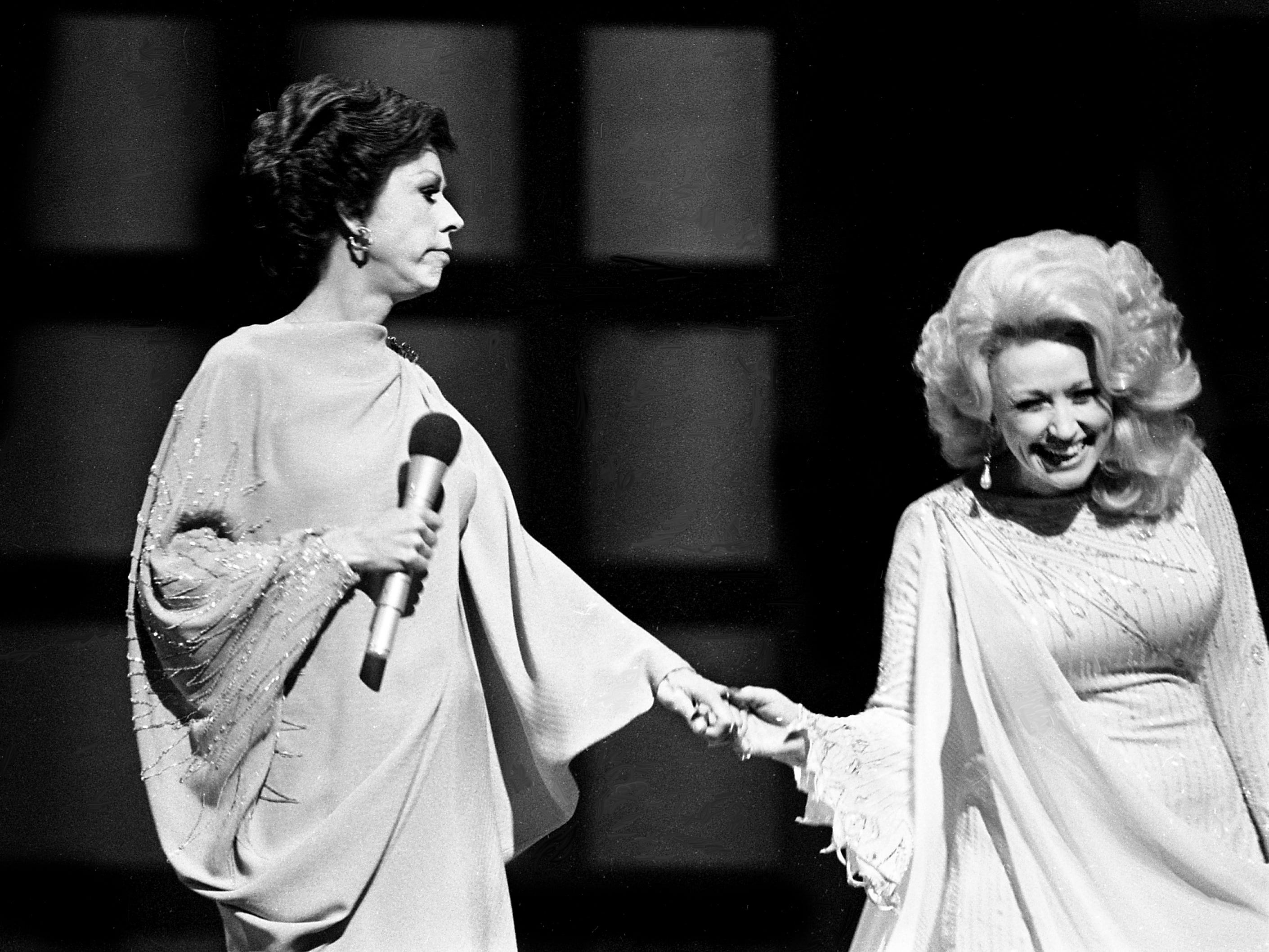 """Dolly Parton, right, joins Carol Burnett for the """"Pedestal Song"""" skit during the taping of the """"Dolly and Carol in Nashville"""" television special before a packed audience at the Grand Ole Opry House Jan. 10, 1979. The special airs on CBS Feb. 14."""