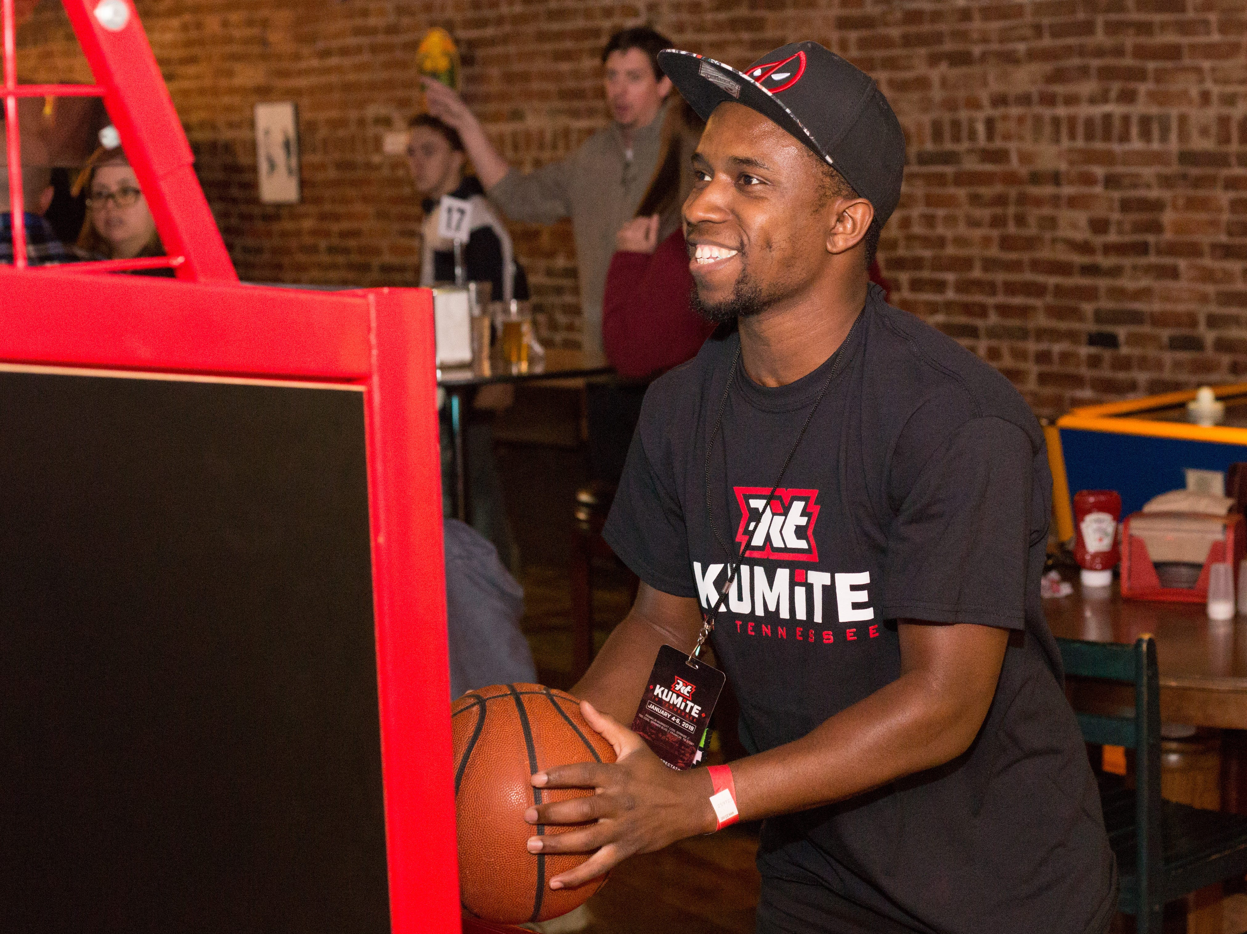 Walter Witherspoon takes time to shoot some hoops during a Super Smash Brothers Ultimate Tournament presented by Big Dad Games at Filly's Game and Grill in Gallatin on Monday, Jan 14.