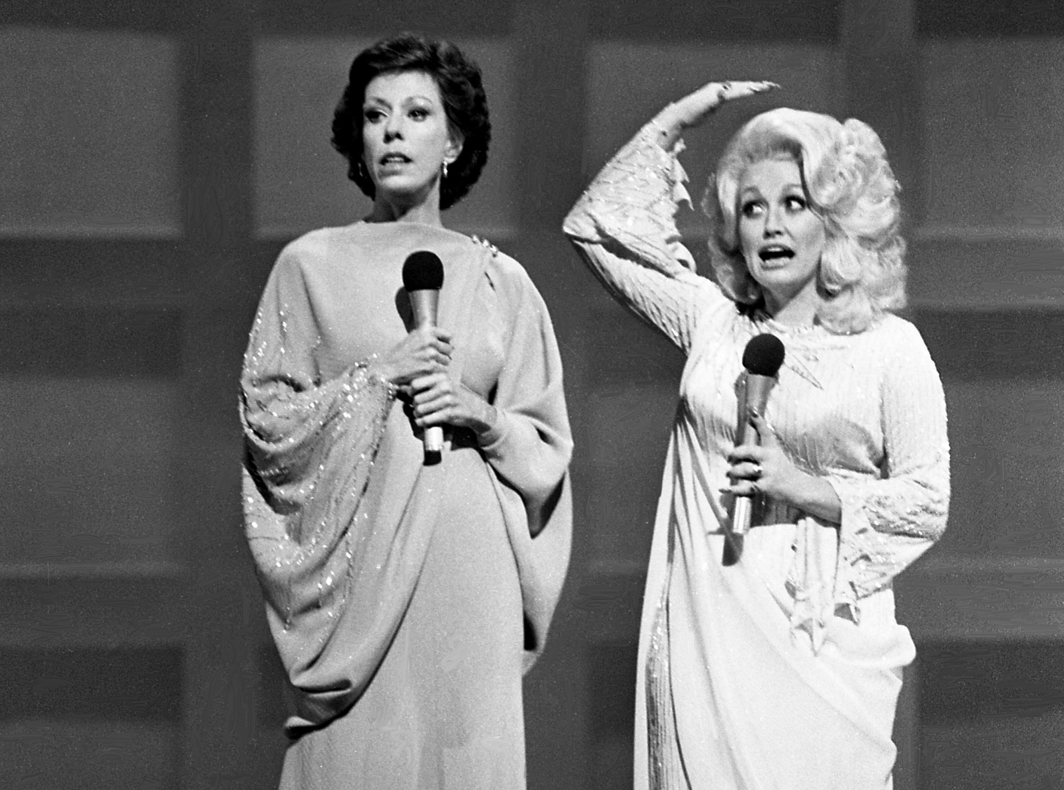 """Carol Burnett and Dolly Parton perform the """"Pedestal Song"""" skit during the taping of the """"Dolly and Carol in Nashville"""" television special before a packed audience at the Grand Ole Opry House Jan. 10, 1979."""