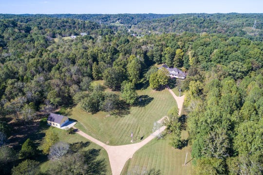 This aerial view shows the secluded woods and lawn at 1333 Hogans Branch Road.
