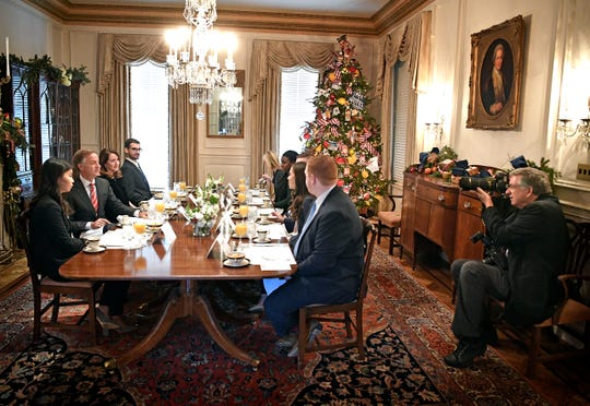 Jed DeKalb, right, blends into the scene as Governor Haslam entertains. Dekalb will retire soon as the state photographer who has worked under five governors.  Tuesday Dec. 18, 2018, in Nashville, Tenn.