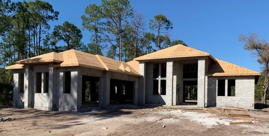 Construction has begun on this custom home by Nova Homes of South Florida on Pine Ridge Road.