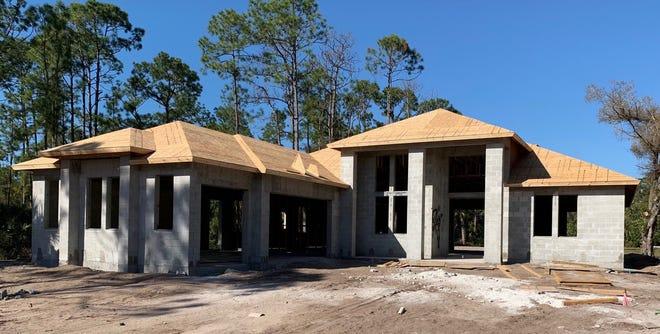 Construction has begun on this custom home by Nova Homes of South Florida on Pine Ridge Road.