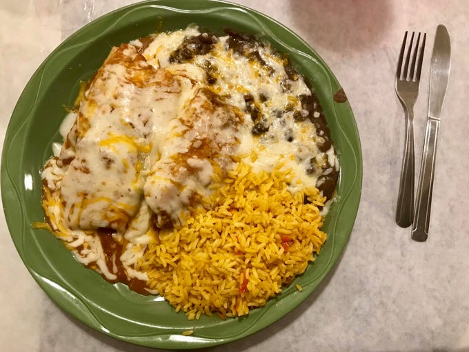 Pork tamales smothered in cheese at La Bamba, which reopened a Naples location in late November.