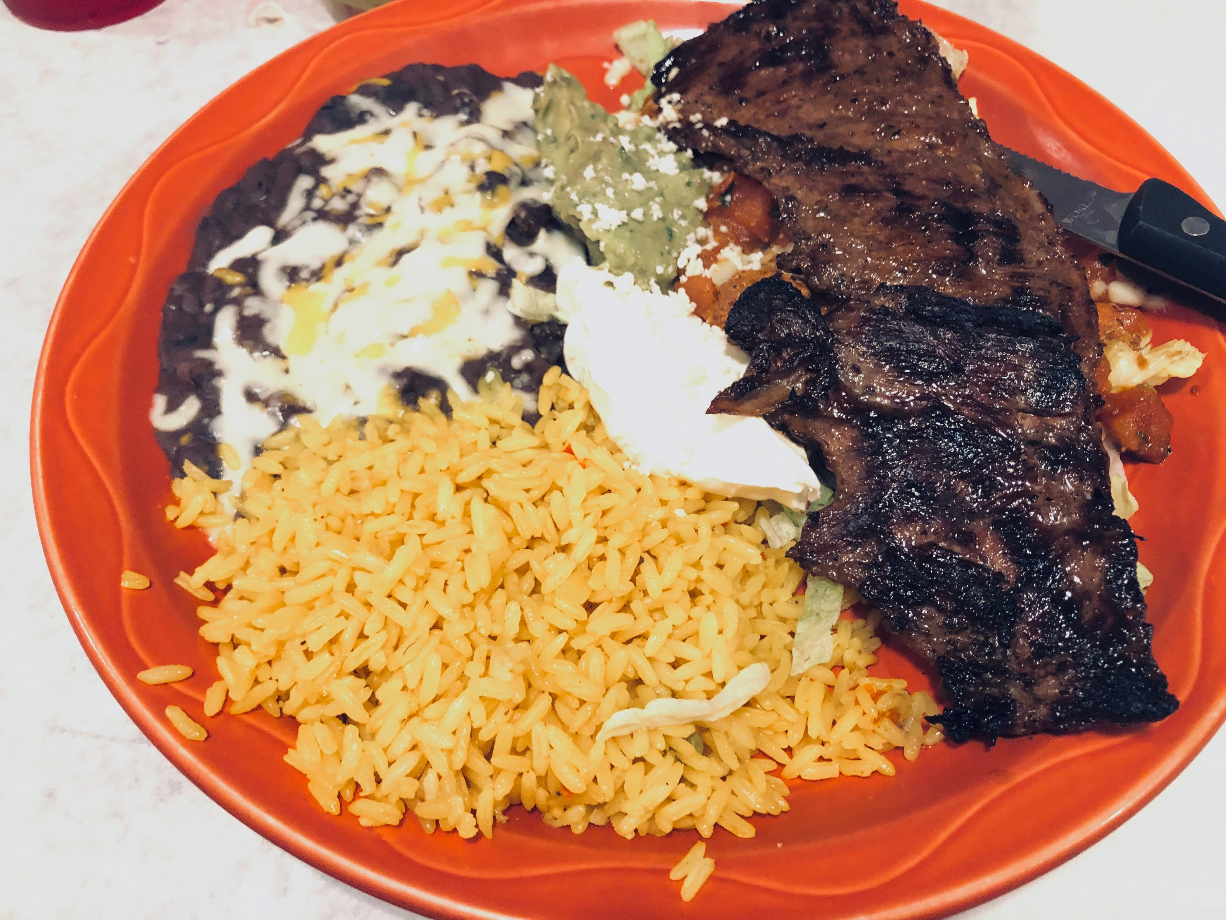 A grilled steak atop chorizo is served with four corn tortillas at La Bamba, which returned to the Naples area in November.