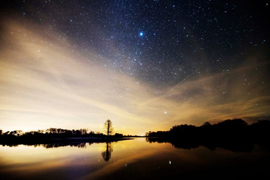 Stars rise over the restored part of the Kissimmee River near Highway 98 in Northern Everglades. The river is being restored to ease flows along with recreating its natural flow along with providing more habitat for wildlife.