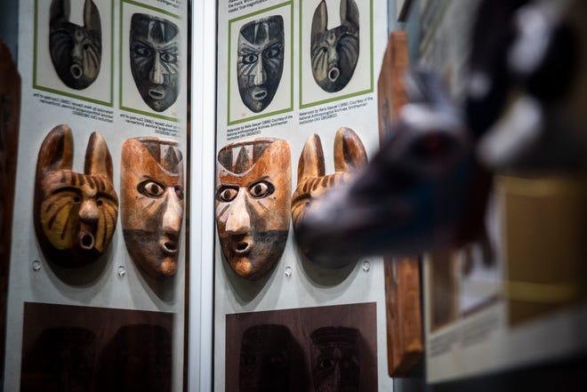 A display case details the history of the many wooden masks found on an archeological dig in the late 1800s, which were worn by the Calusa people for religious ceremonies, at the Marco Island Historical Museum on Marco Island on Tuesday, January 15, 2019.