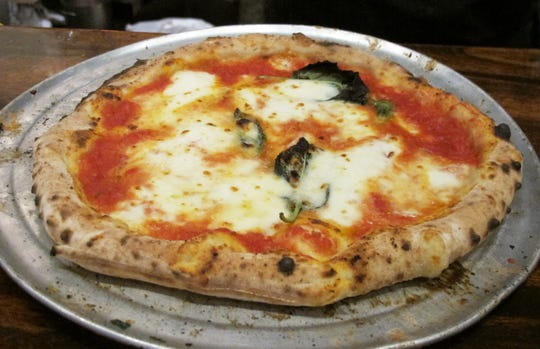 Wood-fired, Neapolitan-style pizzas are a specialty of the new Trattoria Abruzzo in the Galleria Shoppes at Vanderbilt in North Naples.