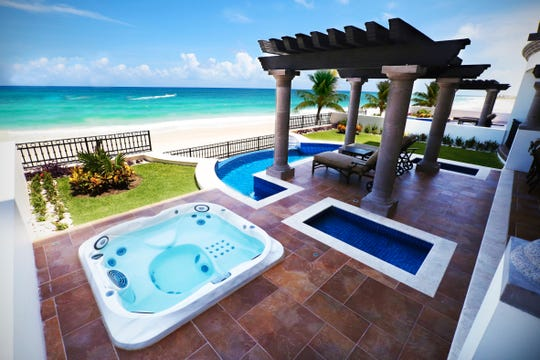 Online auction lots up for bid from Jan. 20-31 include a four-night stay for two couples in a two-bedroom villa with a private pool at the all-inclusive Royal Resorts Grand Residences Riviera Cancun.