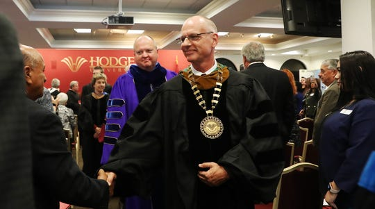 John Meyer is congratulated by Israel Suarez after his inauguration ceremony for president of Hodges University on the Naples campus on Tuesday 1/15/2019.