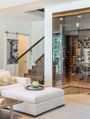 This custom wine room can hold more than 300 bottles.