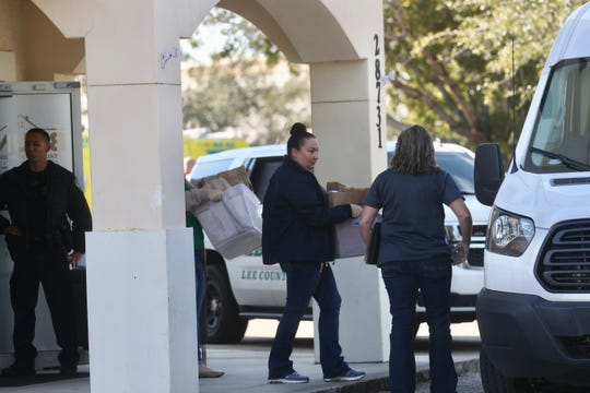Boxes of items are brought out of Bruno Total Home in Bonita Springs on Tuesday, Jan. 15, 2019. There is a large law enforcement presence at the site that includes Lee County Sheriff's Office and Cape Coral Police Department. An officer stated it was a state investigation.