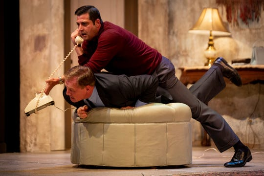 "James Duggan holds down Brett Marston to keep his friend from escaping while he make evening plans for him during ""Don't Dress for Dinner,"" from the Naples Players at Sugden Community Theatre in Naples on Monday, January 14, 2019."