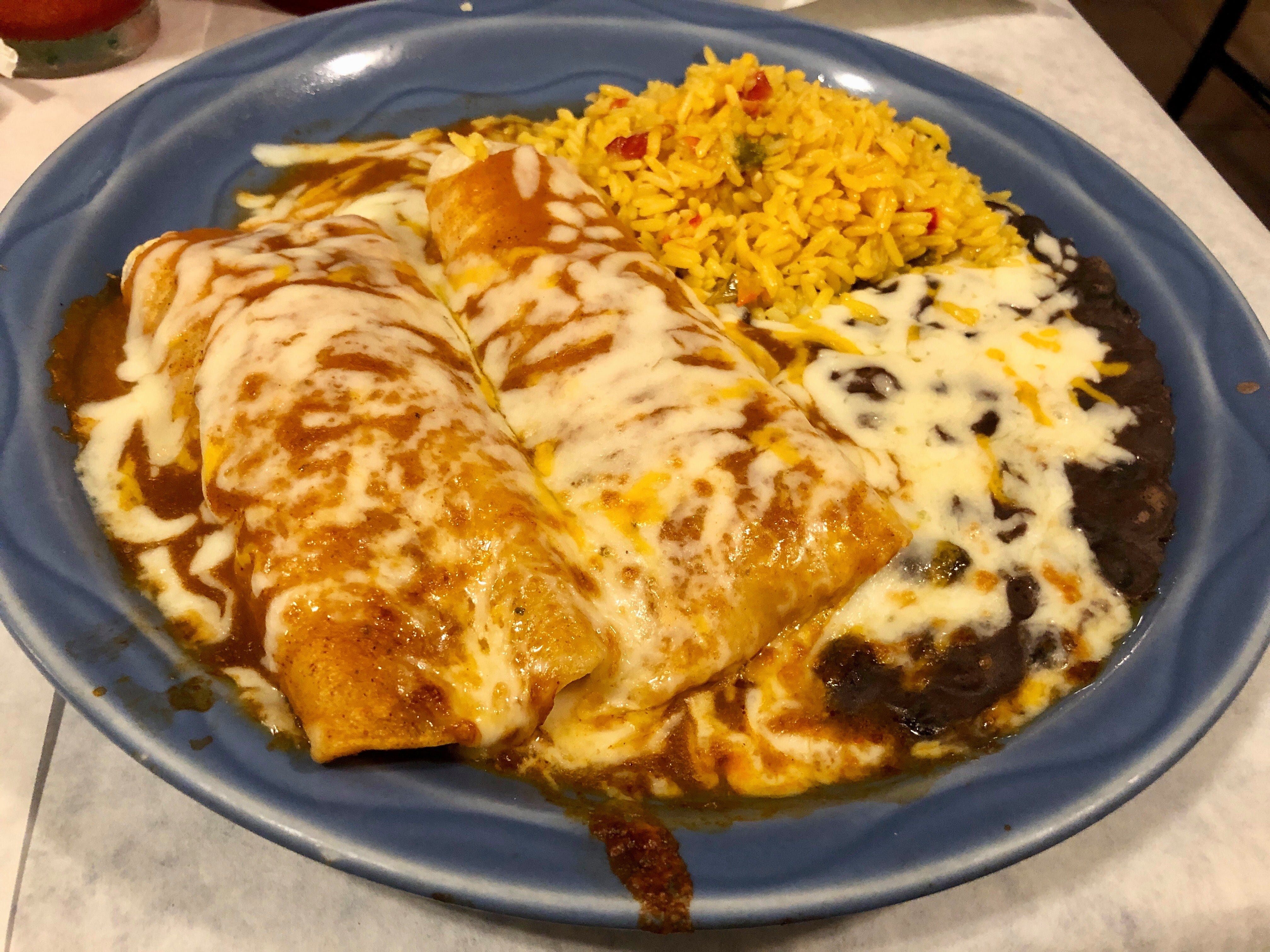 Chicken enchiladas with rice and beans at the new La Bamba location in East Naples.