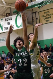 Fisher Catholic senior Max Shaw shoots as Newark Catholic senior Heath Jeffries tries to block during Monday night's game at Newark Catholic. The Irish won with a buzzer-beating 3-pointer defeating the Green Wave 52-49.
