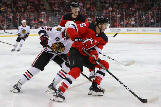 Jan 14, 2019; Newark, NJ, USA; New Jersey Devils center Kevin Rooney (58) skates with the puck during the first period of their game against the Chicago Blackhawks at Prudential Center.