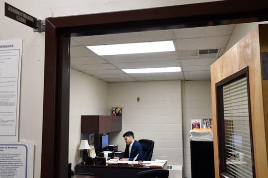 Chowdhury works diligently inside of his office.