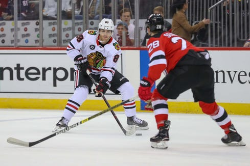 Jan 14, 2019; Newark, NJ, USA; Chicago Blackhawks right wing Patrick Kane (88) skates with the puck while being defended by New Jersey Devils defenseman Damon Severson (28) during the first period at Prudential Center.