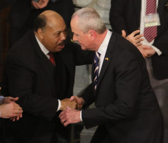 New Jersey Democratic State Committee chairman John Currie with NJ Governor Phil Murphy as Murphy exits the Assembly chamber following his State of the State address on January 15, 2019.