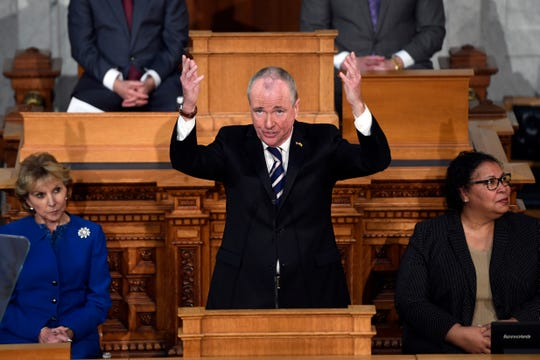 New Jersey Gov. Phil Murphy gestures to his Cabinet as he delivers his first State of the State address on Tuesday,  Jan. 15, 2019, in Trenton.