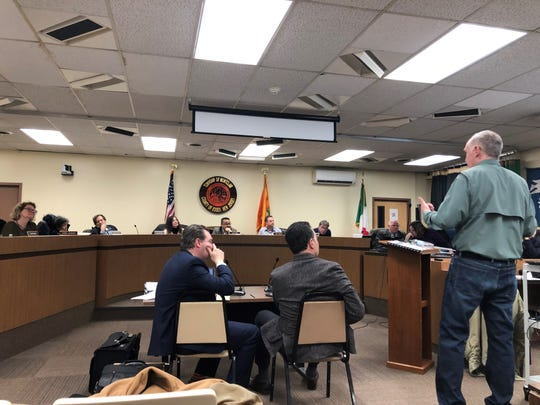 Resident Frank Rubacky presents an alternative plan on the Lackawanna Plaza redevelopment application to the Montclair Planning Board while attorney Tom Trautner and developer Brian Stolar look on. January 2019.