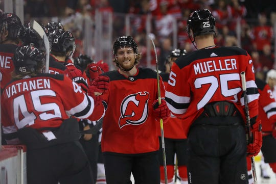 Jan 14, 2019; Newark, NJ, USA; New Jersey Devils center Blake Coleman (20) celebrates his goal during the first period of their game against the Chicago Blackhawks at Prudential Center.