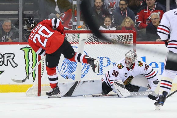 Jan 14, 2019; Newark, NJ, USA; New Jersey Devils center Blake Coleman (20) scores a goal on Chicago Blackhawks goaltender Cam Ward (30) during the first period at Prudential Center.