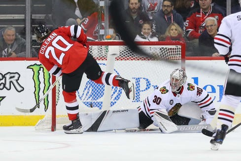 Jan 14, 2019; Newark, NJ, USA; New Jersey Devils center Blake Coleman (20) scores a goal on Chicago Blackhawks goaltender Cam Ward (30) during the first period at Prudential Center.