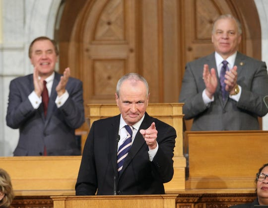 Governor Phil Murphy, with Assembly Speaker Craig Coughlin and Senate President Stephen Sweeney behind him, makes a point during his State of the State address on Tuesday, Jan. 15, 2019.