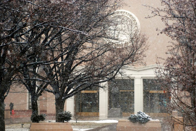 Snow falls on the New Mexico state Capitol on Friday, Jan. 11, 2019, in Santa Fe, N.M. An overhaul of New Mexico's struggling public education system is at the forefront of legislative priorities as an expanded Democratic majority arrives at the state Capitol for a 60-day session.