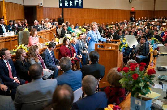 New Mexico Gov. Michelle Lujan Grisham, center, gives her State of the State address during the opening of the New Mexico legislative session at the state Capitol in Santa Fe, N.M. on Tuesday, Jan. 15, 2019.