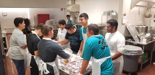 The Oñate Knights baseball team took on the RAKE challenge by helping nutrition workers prepare meals for students.