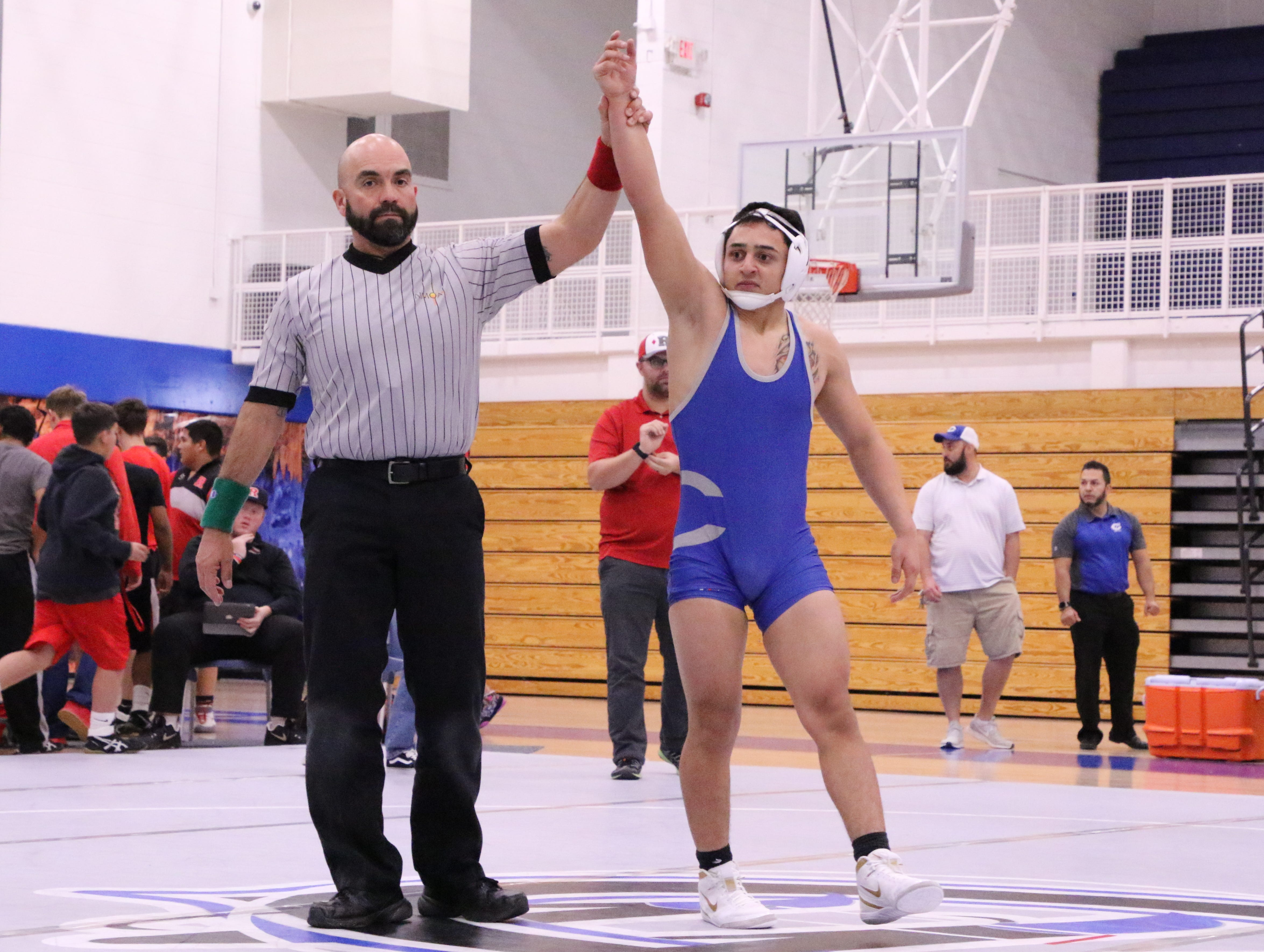 Carlsbad's Ivan Villareal has his hand raised after beating Roswell's Lukus Kasuboski via pinfall during Monday's District Dual.