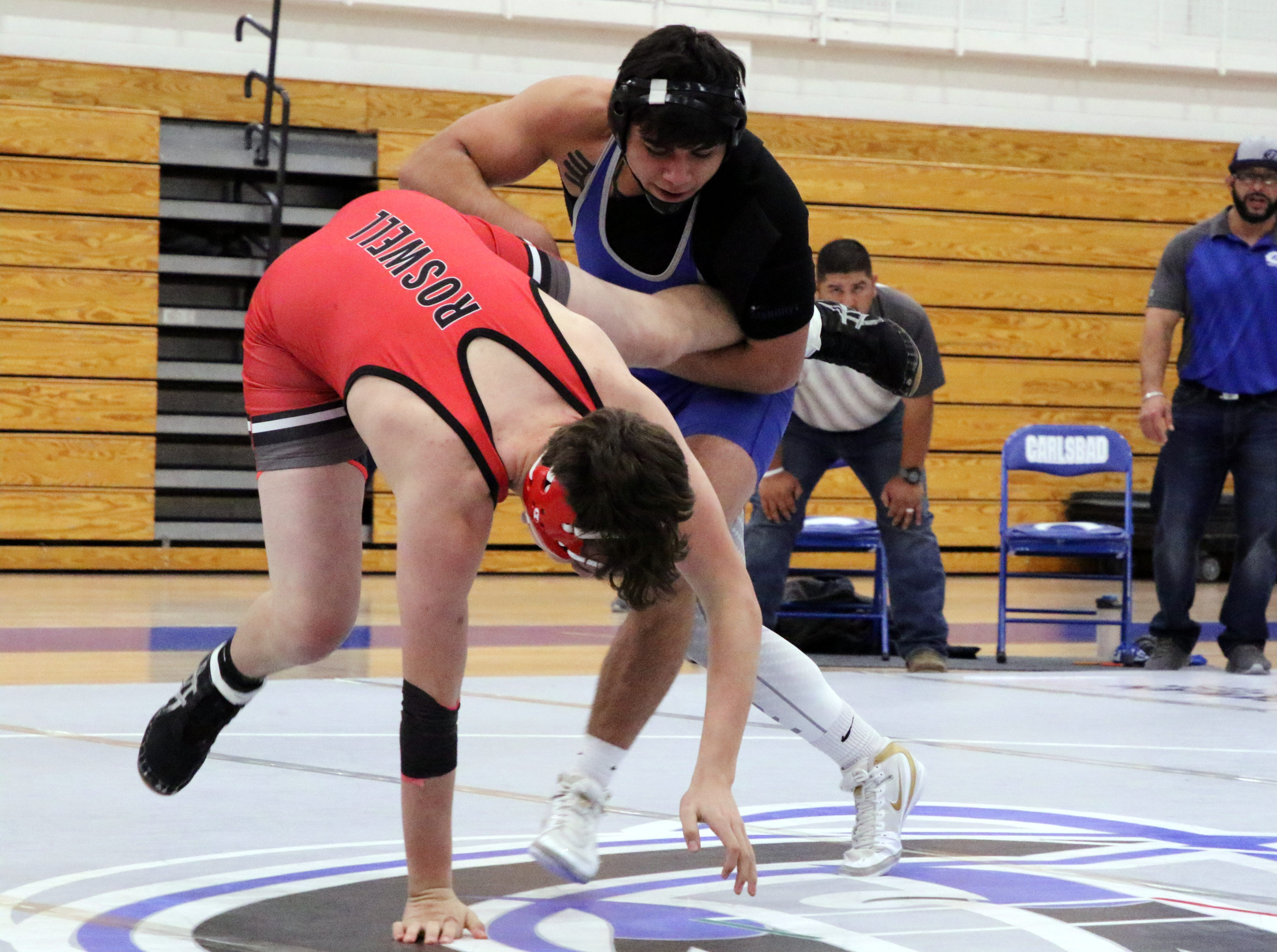 Carlsbad's Fabian Padilla takes Roswell's Canaan Peralta down during Monday's District Dual.