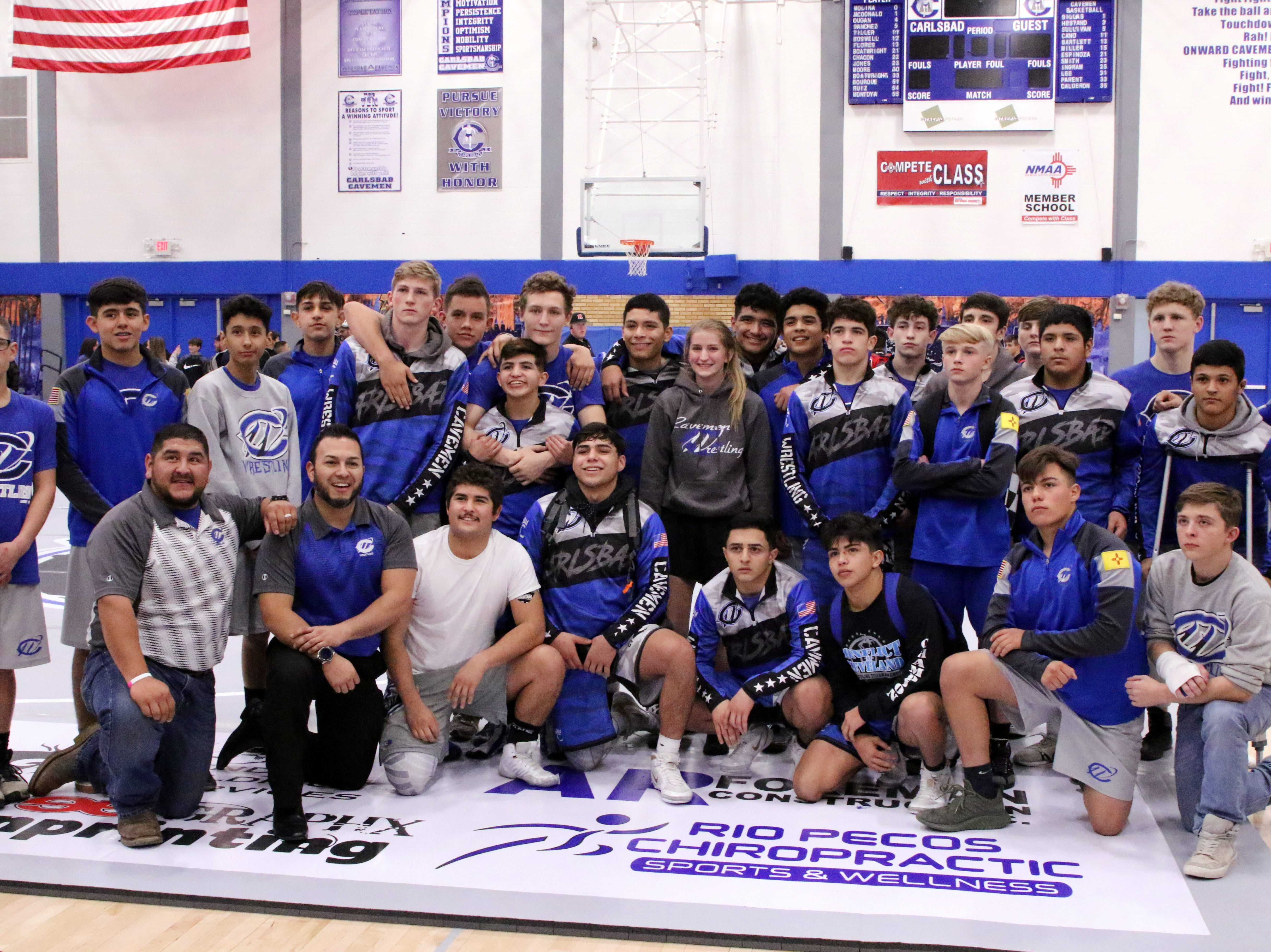The Carlsbad wrestling team poses after Monday's District Dual against Roswell.