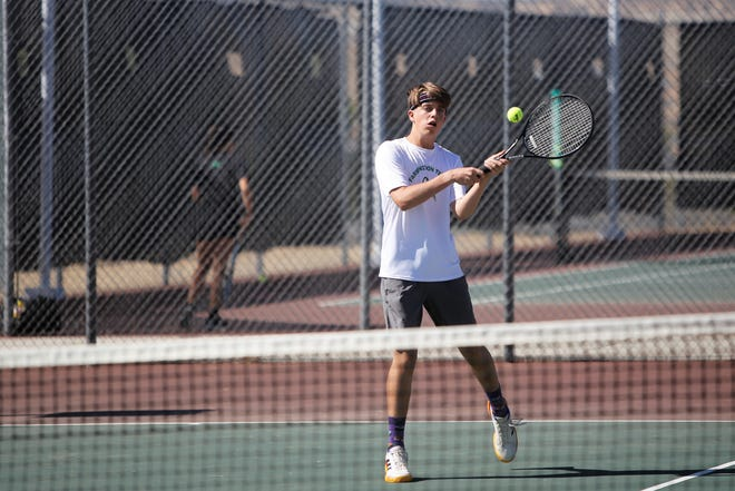 Farmington's Noah Anderson returns a serve against Gallup during boys doubles play on April 21 at the Farmington Sports Complex. The Scorpions will open the 2019 season Feb. 22 in Albuquerque.