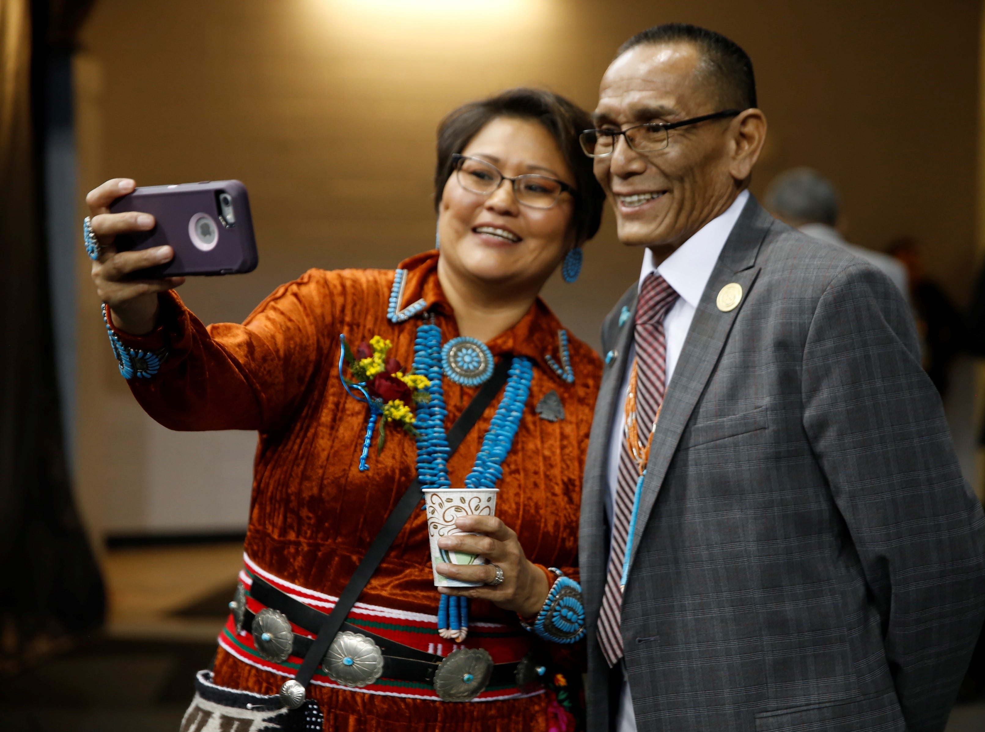 New Navajo Nation Council delegates Eugenia Charles-Newton, left, and Pernell Halona take a selfie before the start of the inaugural ceremony on Tuesday at the Bee Hółdzil Fighting Scouts Events Center in Fort Defiance, Ariz. Charles-Newton will represent Shiprock Chapter.