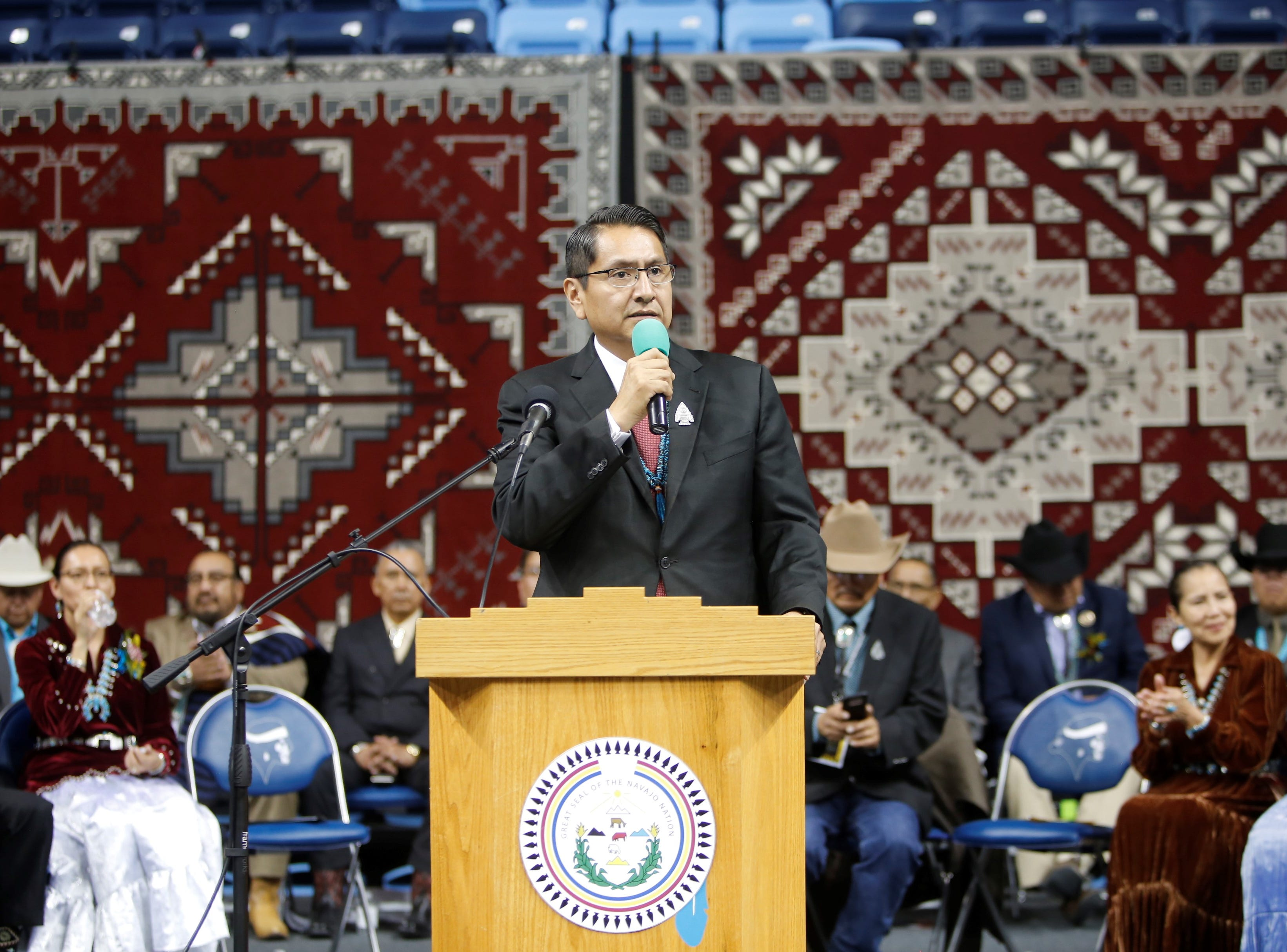 Navajo Nation President Jonathan Nez gives his inaugural address after taking the oath of office Tuesday afternoon at the Bee Hółdzil Fighting Scouts Events Center in Fort Defiance, Ariz.