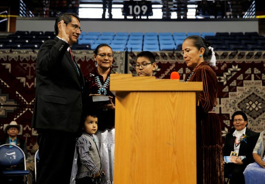 Jonathan Nez, left, takes the oath of office for the Navajo Nation presidency on Tuesday at the Bee Hółdzil Fighting Scouts Events Center in Fort Defiance, Ariz.