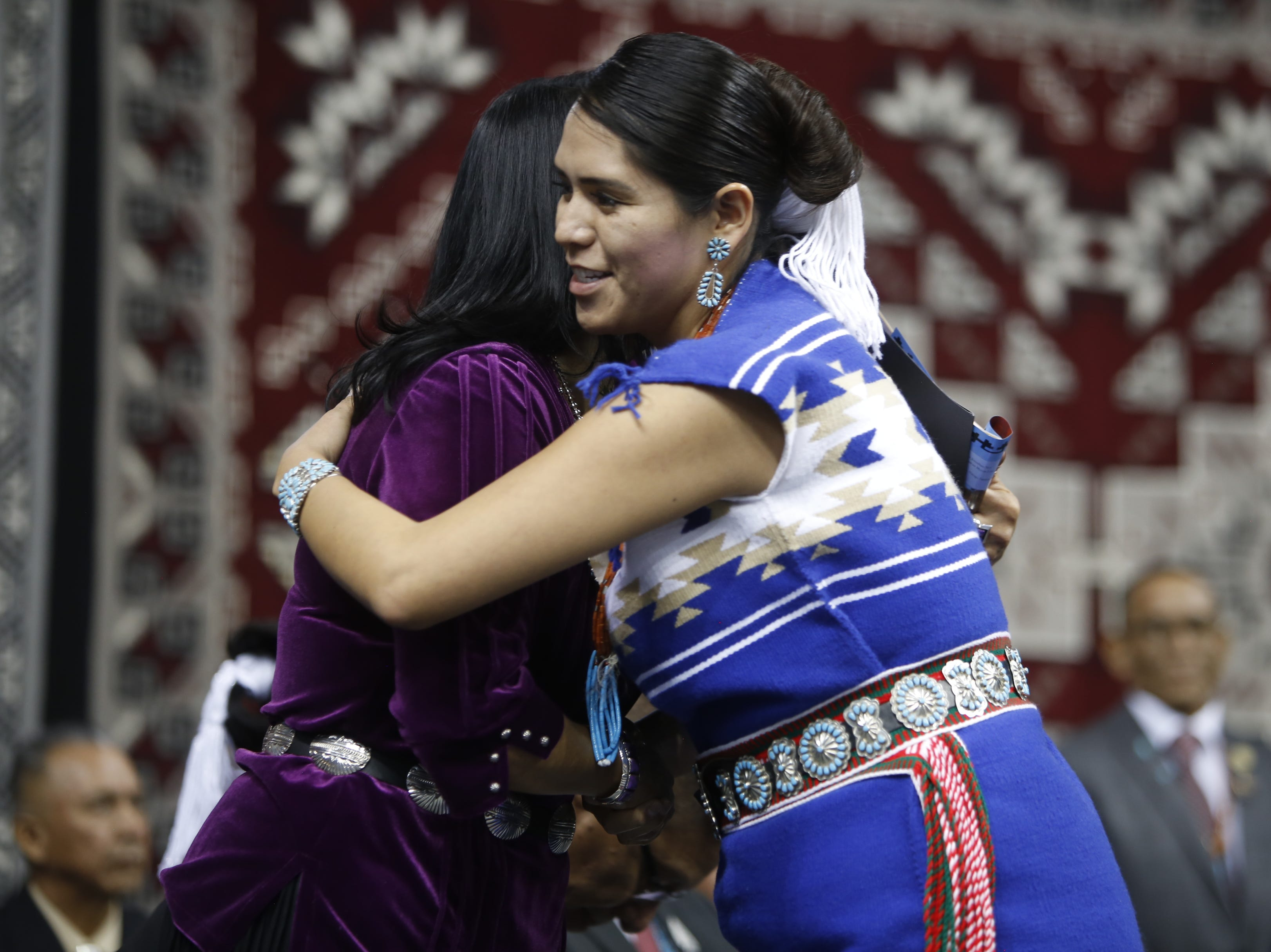 Charlaine Tso, right, hugs Dottie Lizer after taking the oath of office for the Navajo Nation Council. Tso will represent five chapters in the Northern Agency.