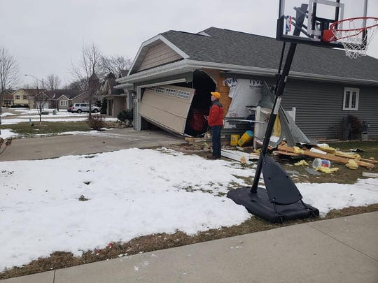 A garage on the 300 block of Foster Street is damaged Saturday morning. Police say a drunken driver hit two homes early Saturday morning.