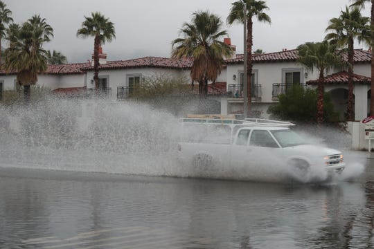 Rainfall in Palm Springs on Monday causes minor flooding on East Palm Canyon Drive, January 14, 2018.