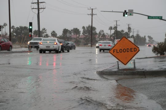 Rainfall in Palm Springs on Monday causes minor flooding on North Indian Canyon Drive, January 14, 2018.