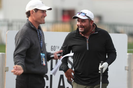 Jose de Jesus Rodriguez talks with his caddie, Mike Dwyer, before teeing off in a practice round at the 2019 Desert Classic, La Quinta, Calif., January 15, 2019.