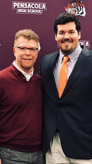 Pensacola High football coach Todd Leonard, left, with offensive lineman and Clemson signee Hunter Rayburn on Dec. 19 at PHS. Leonard became the new PHS head coach on Monday.