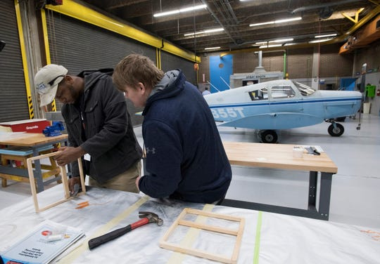 George Stone Technical College students C.J. Nix and Logan Wilson build parts for an aircraft in one of the school's aviation repair labs Jan. 15.
