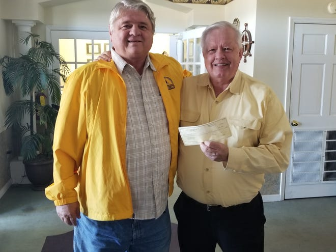 Trustee Phil Gambrell (R) presenting a check for over $6,000 to Coba Beasley, director of Chipola Family Ministries.