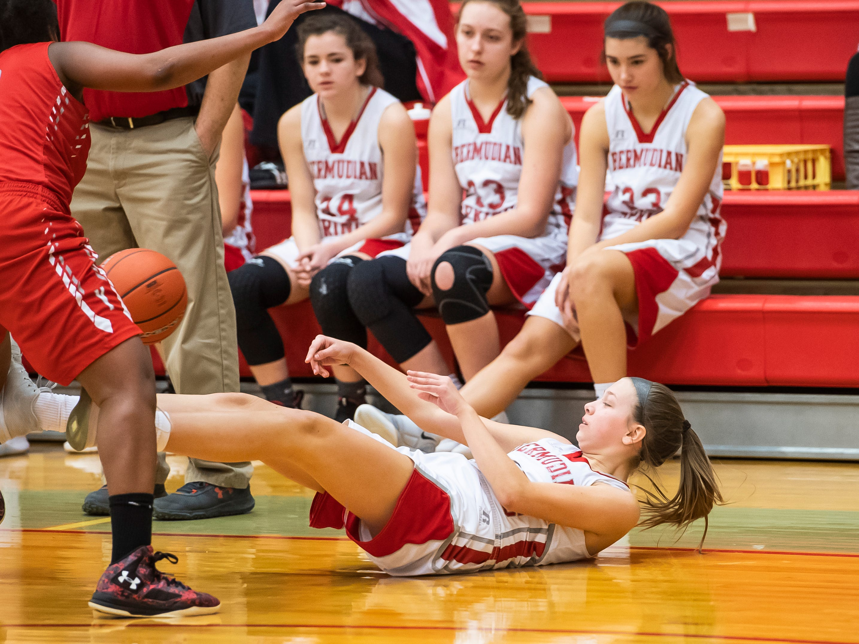 Bermudian Springs' Leah Bealmear slides out of bounds while attempting to save a loose ball during play against York Country Day School at Bermudian Springs High School on Monday, January 14, 2019. The Eagles won 59-20.